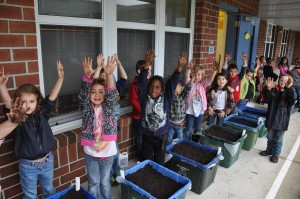 Kids have fun planting the grow boxes.